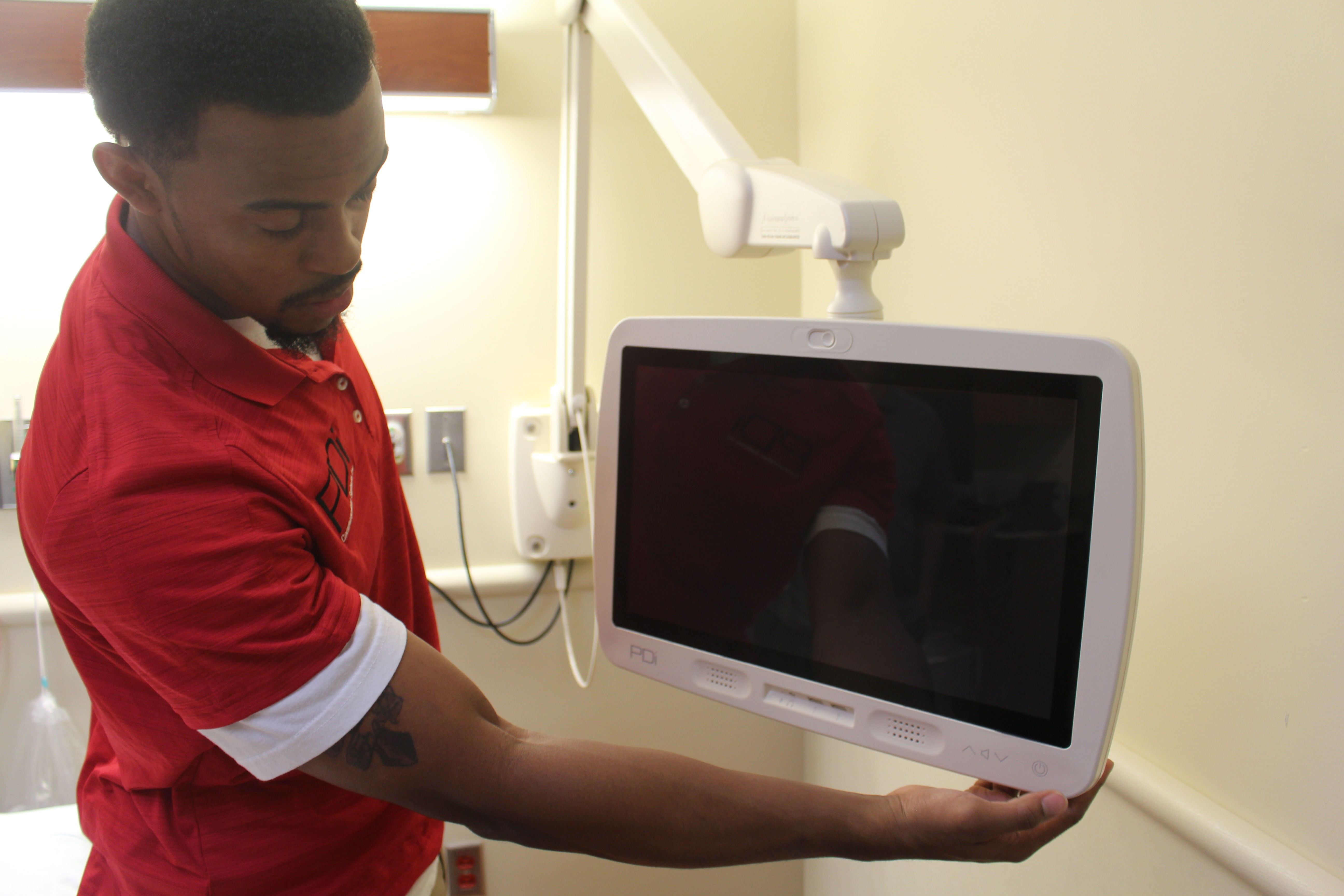 PDi ProServices TV Repair Technician in Hospital Room